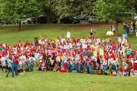 Atlanta, GA, USA - April 29, 2017:  A large group of people dressed as gnomes gather at Inman Park to try and break the world record for gnomes in one place, on April 29, 2017 in Atlanta, GA.