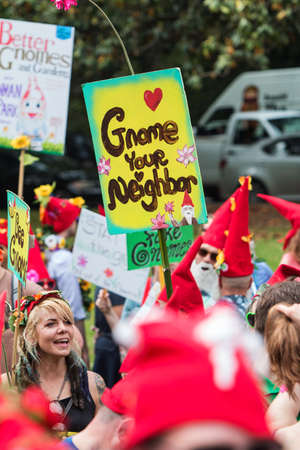 Atlanta, GA, USA - April 29, 2017:  People dressed like gnomes hold up gnome-themed signs as they gather at Inman Park to attempt a world record for most gnomes gathered in one place, on April 29, 2017 in Atlanta, GA.