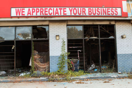 Atlanta, GA, USA - September 23, 2017:  A sign reading We appreciate your business sits atop burned out, abandoned business in Atlanta, GA.