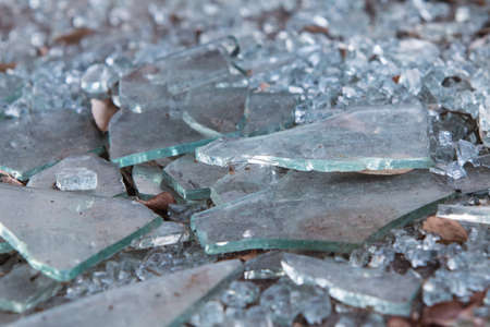 Pieces of broken glass lye on ground at building that has gone out of business Stock Photo