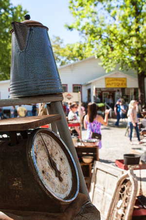 Braselton, GA, USA - April 28, 2018:  People walk and look at antiques on sale at the Braselton Antique Festival on April 28, 2018 in Braselton, GA. Editorial