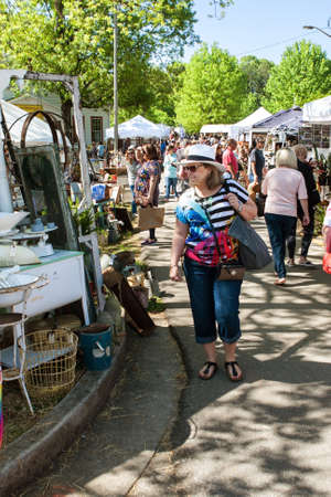 Braselton, GA, USA - April 28, 2018:  A crowd of people walks and looks at antiques on sale at the Braselton Antique Festival on April 28, 2018 in Braselton, GA. Editorial