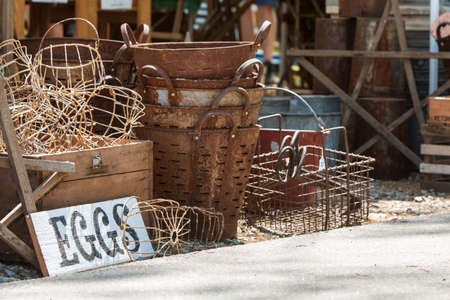 Vintage metal egg baskets sit on sale at Georgia antique festival. Stock Photo - 117651311