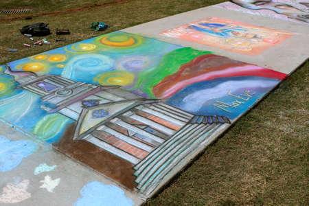 Lawrenceville, GA, USA - April 28, 2018:  Chalk art covers a sidewalk at a public park at the Lawrenceville Arts Fest on April 28, 2018 in Lawrenceville, GA. Stock Photo - 117652008