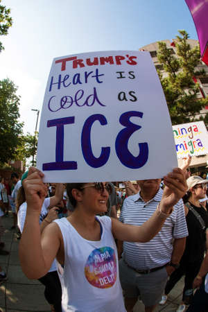 Atlanta, GA, USA - June 30, 2018:  A woman holds a sign saying Trumps heart is cold as ICE at an immigration law protest and march in Atlanta, GA.
