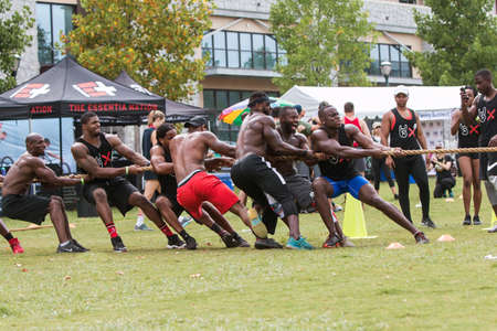 Atlanta, GA, USA - July 14, 2018:  A team of muscular African American men compete in a tug of war match at  at Atlanta Field Day, on July 14, 2018 in Atlanta, GA. Editorial