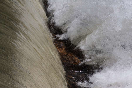 Closeup of water from a waterfall violently splashing off rocks in a North Georgia river. Stock Photo