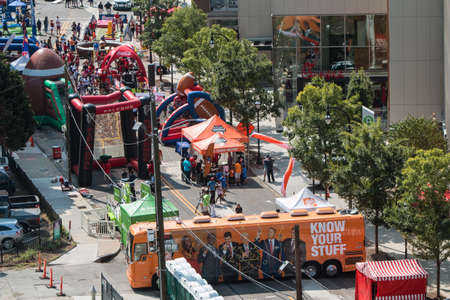 Atlanta, GA, USA - August 25, 2018:  High-angle perspective of inflatables and games set up along Marietta Street where people participate in the Chick-Fil-A Football Fan Fest to commemorate the start of the college football season on August 25, 2018 in A