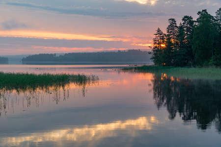 Sunrise over a calm lake in Filipstad Sweden