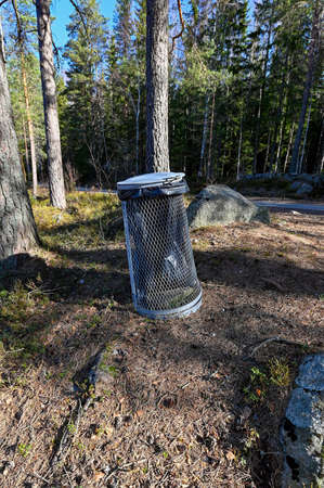 Garbage can near a little lake in Sweden