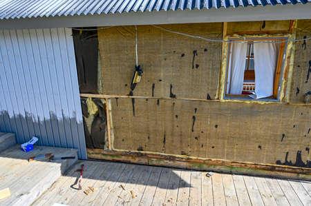 wooden plank debris infront of a wall Standard-Bild