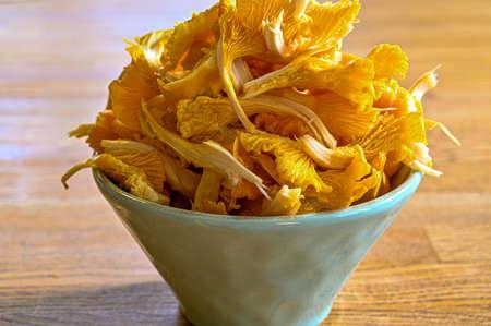 fresh yellow chanterelles in a bowl an a table Stock fotó
