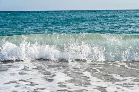 waves in mediterranean sea hitting the beach Stockfoto