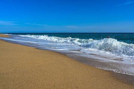 sandy beach and waves in Mediterranean sea near Malgrat de Mar