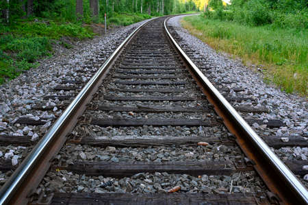 low perspective of rail tracks into a bend