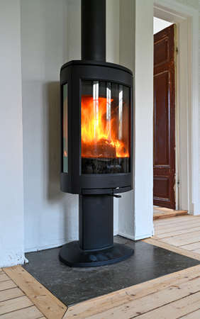 cast iron stove standing tall in livingroom