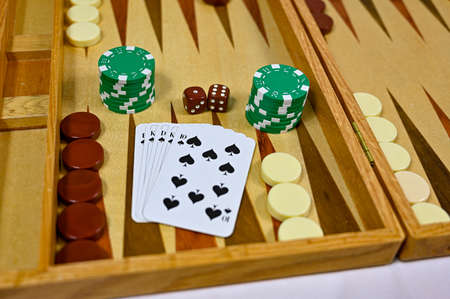 backgammon board with game pieces cards and dices