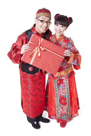 Sweet couple in traditional Chinese clothing holding gift boxes