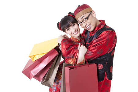 Sweet young couple in traditional Chinese clothing going shopping