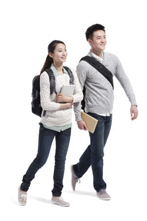 way out: Happy college couple walking side by side