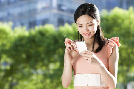 people: Young Chinese woman with mobile phone