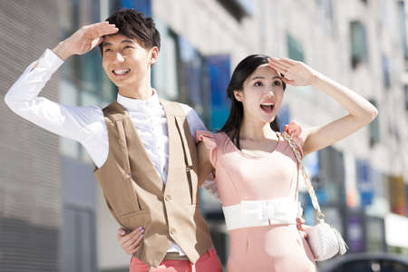 Stylish young Chinese couple looking at view LANG_EVOIMAGES