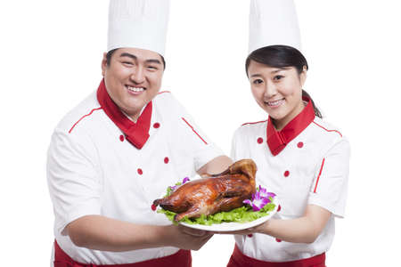 Cooks with roast duck LANG_EVOIMAGES