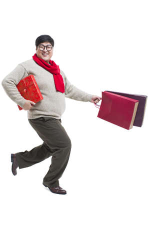 lipid: Happy young man with Chinese New Years gifts