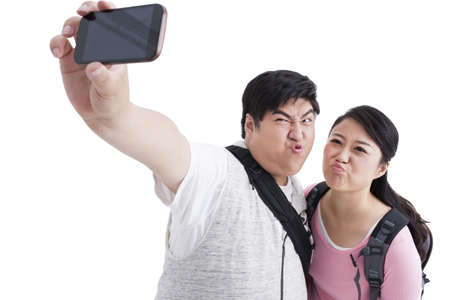 Young college couple making self portrait
