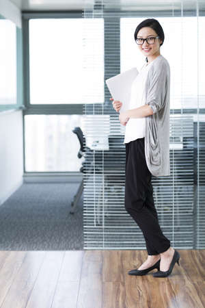Cute businesswoman with laptop in the office