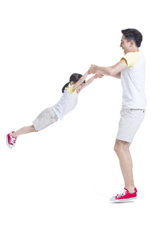 Father spinning daughter