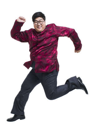 lipid: Chubby young man in Tang suit jumping excitedly