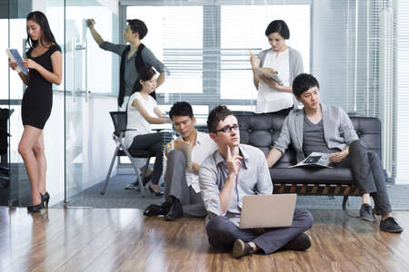 open floor plan: Office workers pondering over thorny problems