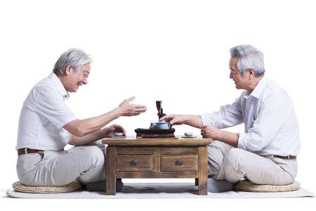indian style sitting: Male senior friends having tea