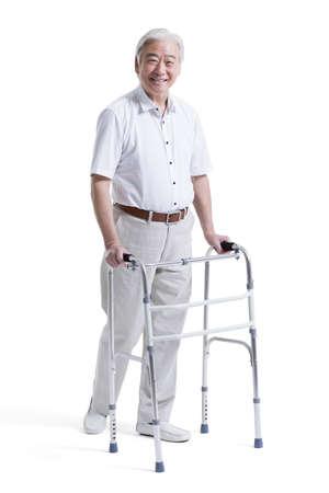 Happy senior man with walker LANG_EVOIMAGES