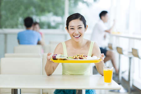 Young woman having a meal in restaurant