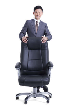 Mature businessman with boss chair LANG_EVOIMAGES