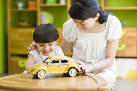 Mother and daughter playing toy car