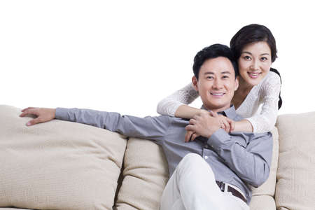 Young couple in living room LANG_EVOIMAGES