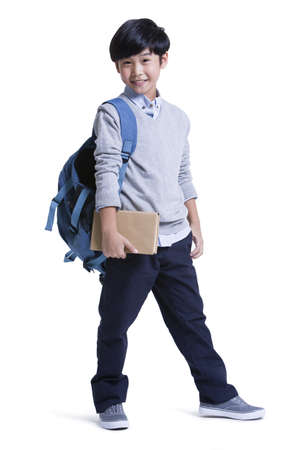 Portrait of cute schoolboy
