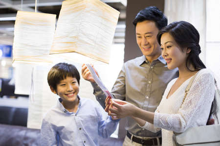 lamp shade: Happy family shopping for lamps