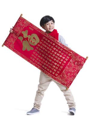 Happy boy celebrating Chinese New Year