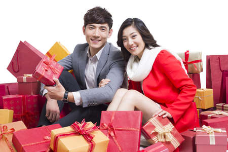 Happy young couple with many gifts