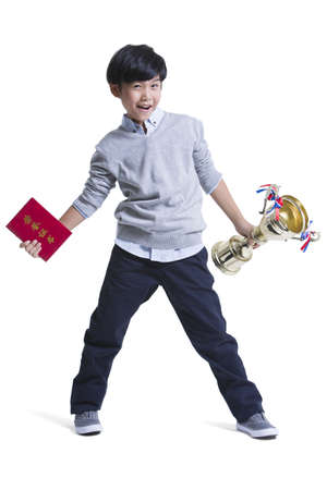 cheer full: Cheerful boy with certificate and trophy