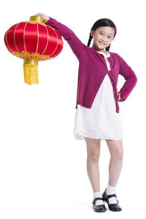 Cute girl with red lantern celebrating Chinese New Year LANG_EVOIMAGES