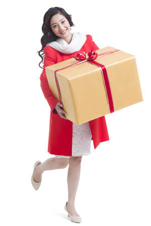 Happy young woman holding a large gift