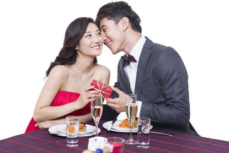 dinner wear: Romantic young couple dating in restaurant