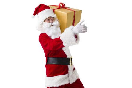 vistiendose: Papá Noel con el regalo pesado de la Navidad LANG_EVOIMAGES