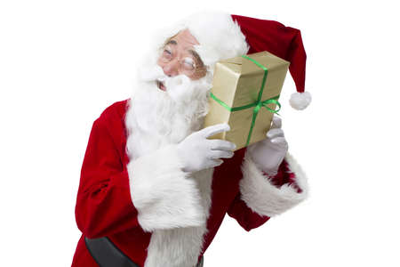 Santa Claus with Christmas gift LANG_EVOIMAGES