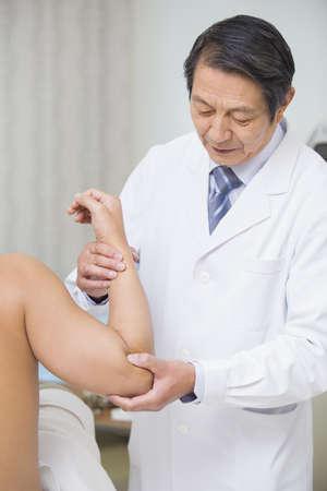 Senior doctor giving massaging LANG_EVOIMAGES